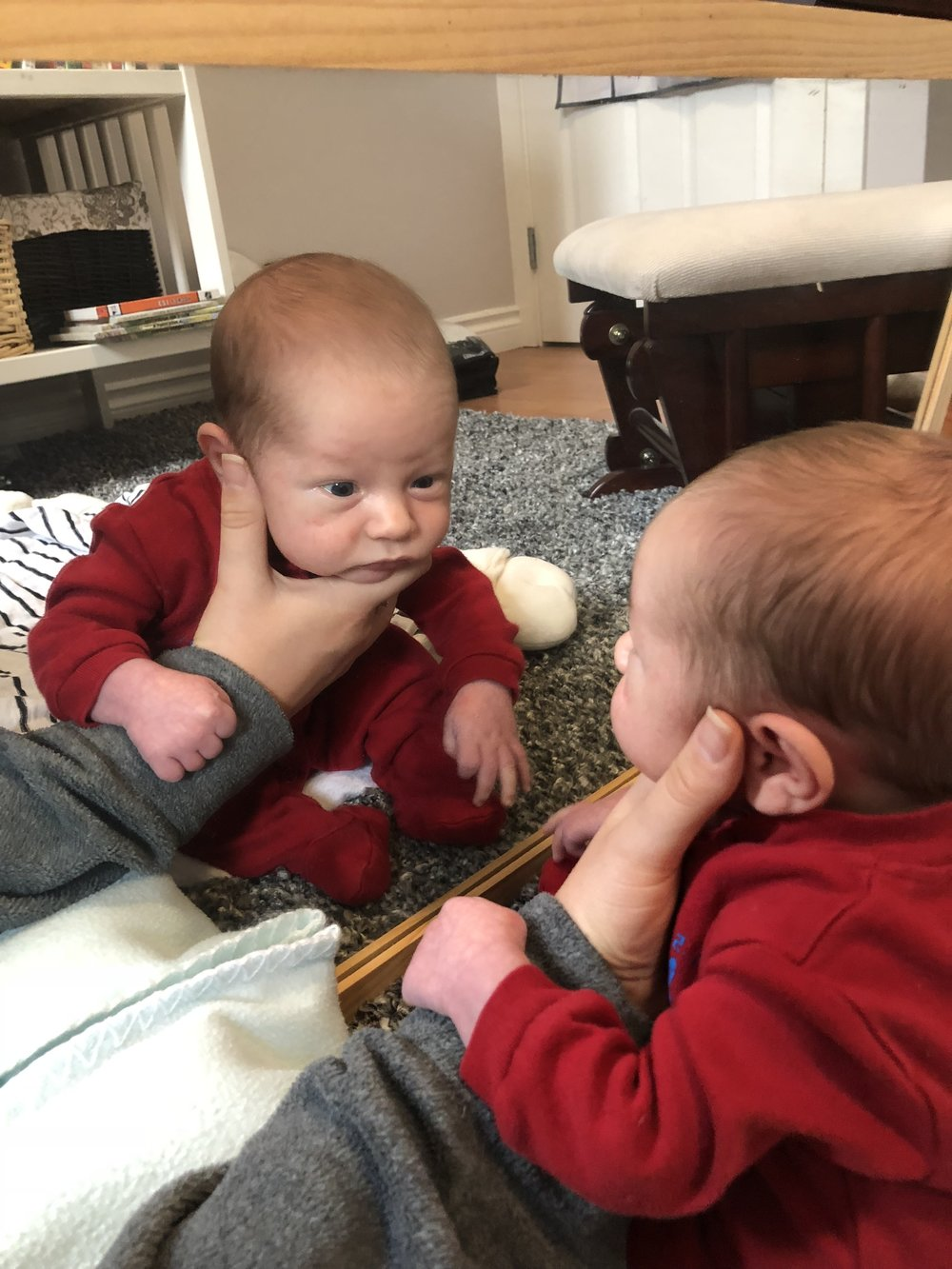 He loves looking at himself in the mirror.