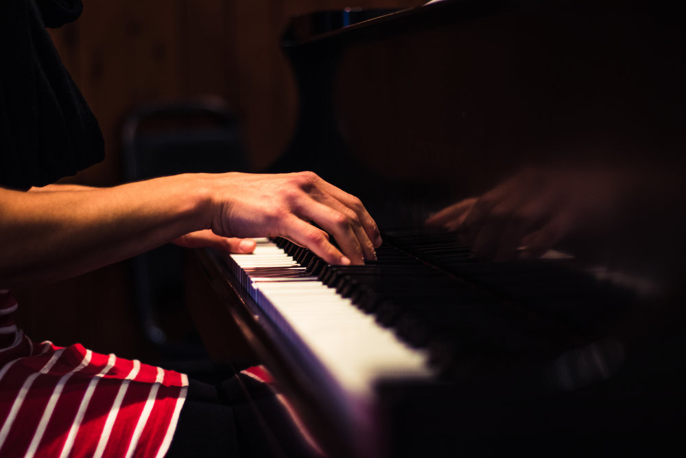 Female hands playing a piano