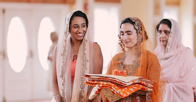 Jasleen was walking down the aisle and she looked nervous. Her sister said something to her and there was a big smile. I wonder what she said but it was beautiful - 4K video frame - #sisters #sikhwedding #gurudwara #weddingcinematography #indianweddingvideography #beautiful #indianweddingcinematography