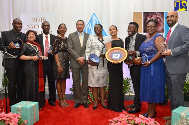 Prime Minister, the Most Hon. Andrew Holness (5th left) with awardees at the Council of Voluntary Social Services (CVSS) 2016 National Volunteer Awards Banquet at The Jamaica Pegasus hotel on December 8 2016. The Young Leader Award was presented to 25-year-old Portmore youth leader Neville Charlton, who is the Youth Director of the Silver Stone Citizens' Association and also heads his own youth group, Youths Inspiring Positive Change Jamaica.