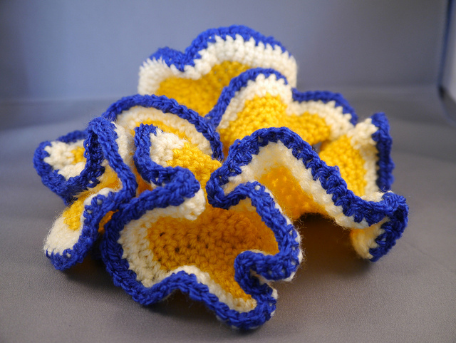 Crochet a hyperbolic plane - The instructions for crocheting a hyperbolic plane are surprisingly easy given the complex surface which is the result. Just perform increases at regular intervals, and soon your crochet will start to resemble a coral or flower, showing the wiggly shape characteristic of hyperbolic geometry.