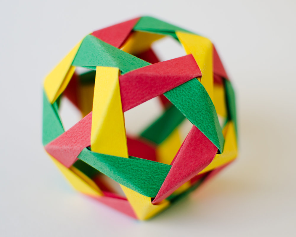 Fold an origami dodecahedron - The instructions for this modular origami dodecahedron involve assembling 30 units of origami, and can be made using a set of sticky notes. For an extra challenge, try creating this model using only three colours, so that the three different colours meet at each corner. It's harder than it looks!