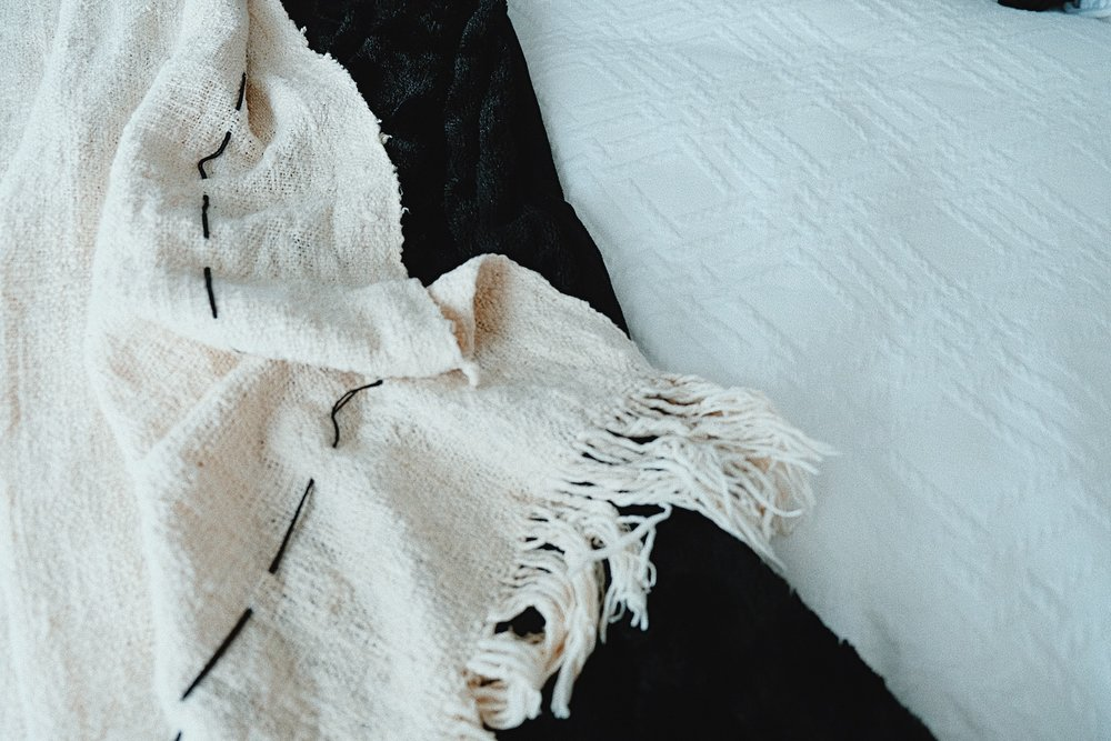 White throw is from Kim Soo  in Bali, sorry Babes, and the black is Logan and Mason.