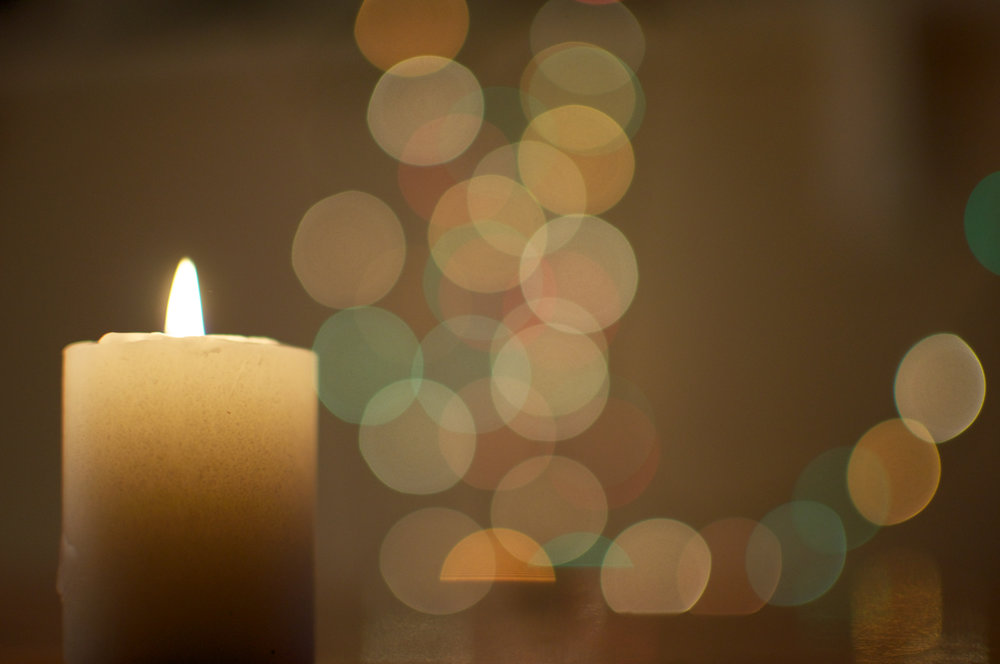 bigstock-Burning-Candle-with-Lights-56086019.jpg