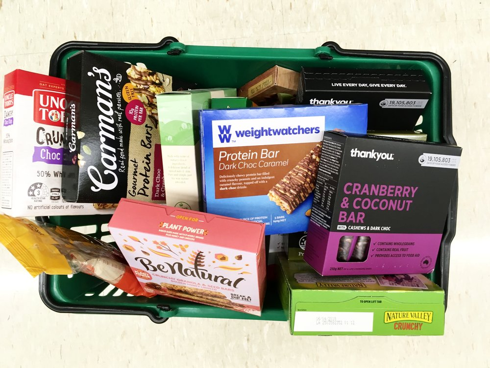A basket FULL OF MUESLI BARS IS ONLY THE START! WITH OVER 80 OPTIONS, HOW THE HELL DO YOU CHOOSE?