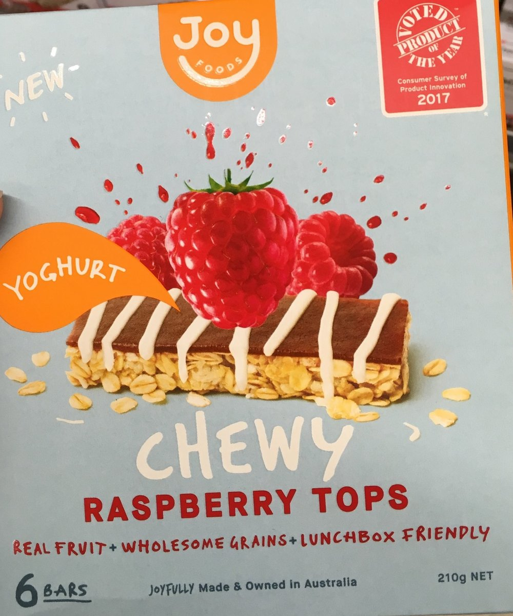 Joy Foods Chewy Strawberry Tops: - What's good: Joy foods is an Australian owned Family business and we here at Be Well Fed Nutrition Hub & Kitchen we love Australian owned. There packaging is cardboard and able to be recycled so that gets a tick from us!Nutritionally, at 35g and less than 600kJ per bar, these bars contain 9.6% of the recommended amount of daily fibre and have 2.3g of protein per serve, meaning they are likely to keep you full and satisfied. Finally, sodium is less than 120mg per 100g which is typically hard to find and a better choice.