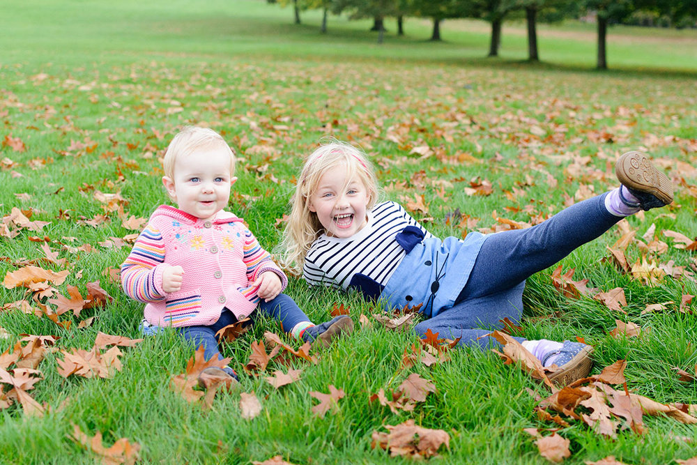 These two girls loved the autumn leaves at Wollaton Hall, Nottingham