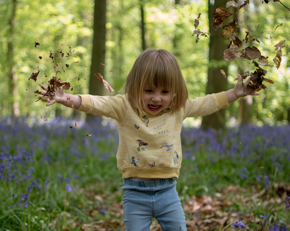 This young lady absolutely loved throwing leaves in the air. Would you believe she was incredibly shy, nervous just 10 minutes before this picture?