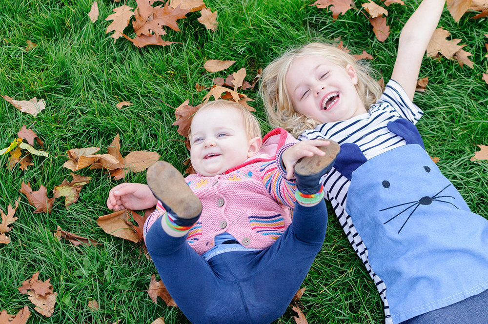 These adorable little kids loved rolling around in the autumn leaves and mum even started throwing them up in the air to their delight!