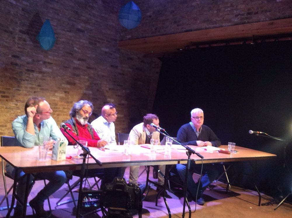 Verma in red, me centre, listening to Jonathan Meth (far right) sitting on the earth floor (visible though not obvious) hosting a panel on East Asian theatre and networks - another valuable use of the space.  Sadly, no petals. Tara Theatre.