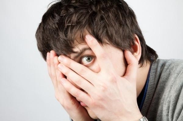 scared-man-covering-eyes-ftr.jpg