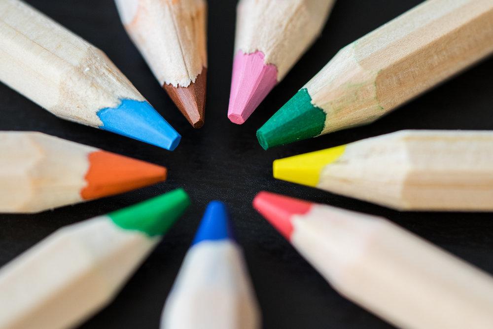 colored-pencils-in-a-circle-on-a-black-desk-picjumbo-com.jpg