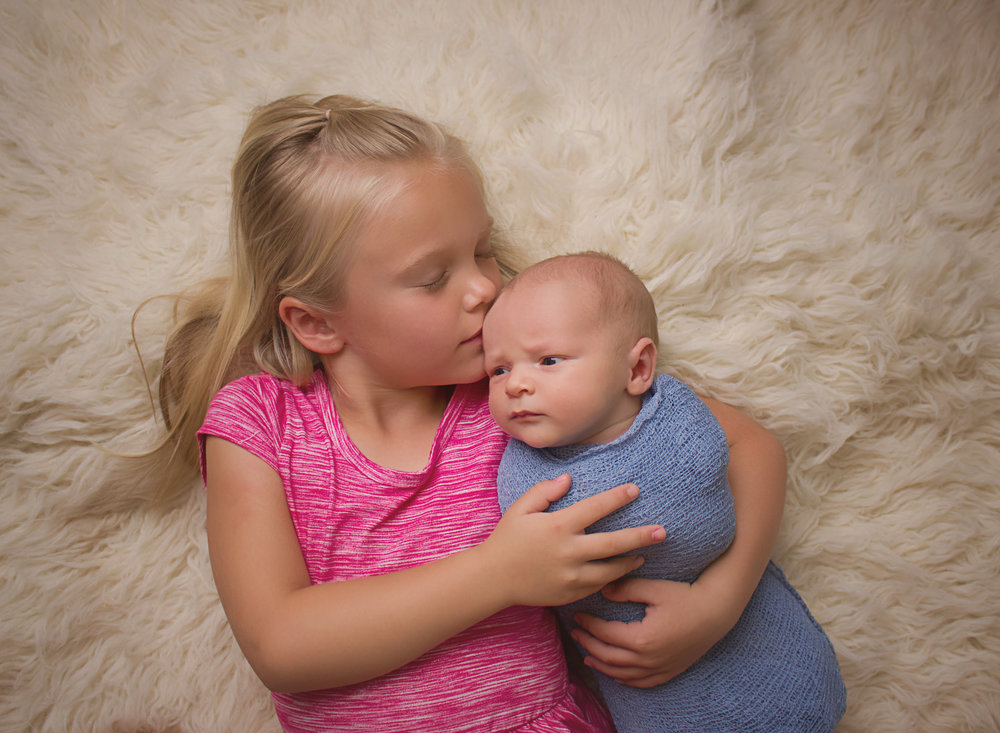 newborn with sister