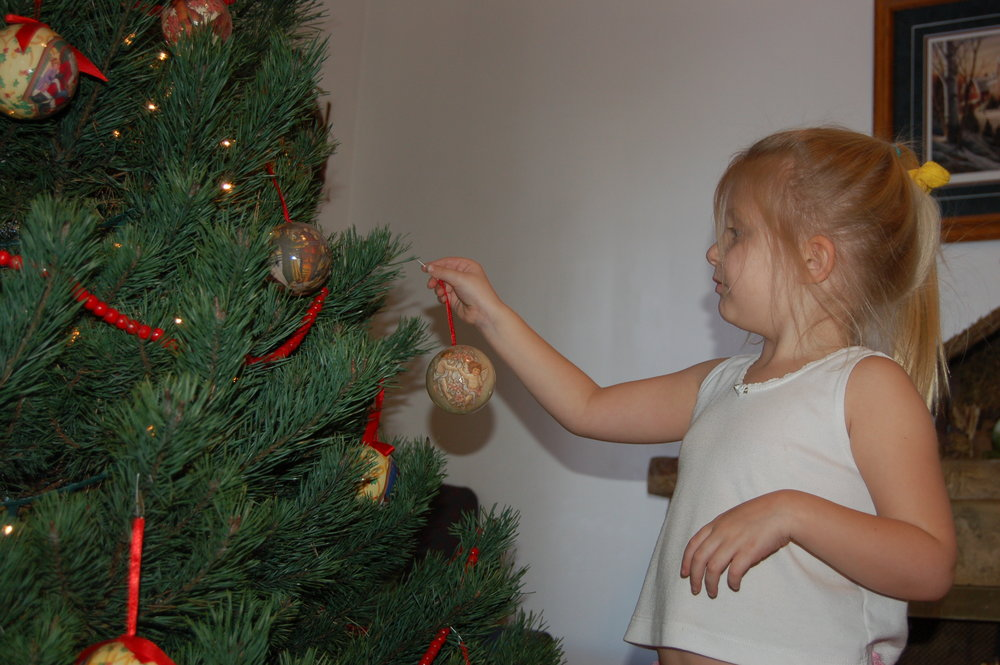 Decorating the Christmas Tree is always a favorite. We've had a real tree every year and I wouldn't trade it for anything! One of my favorite traditions is going out Thanksgiving break and cutting it down.
