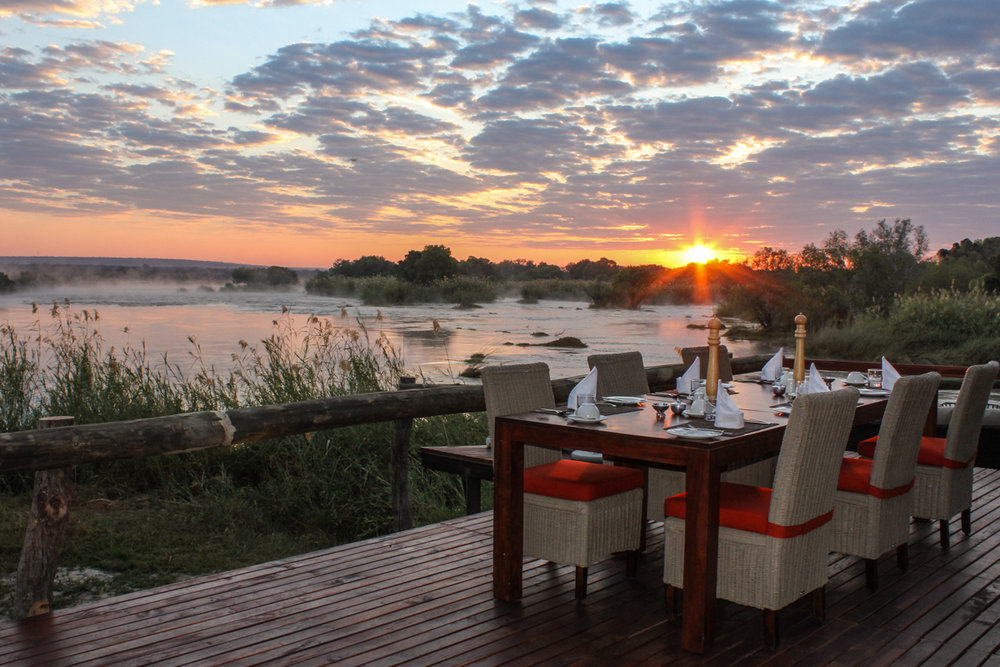 18. Imvelo Safari Lodges - Zambezi Sands - Breakfast table at sunrise.jpg