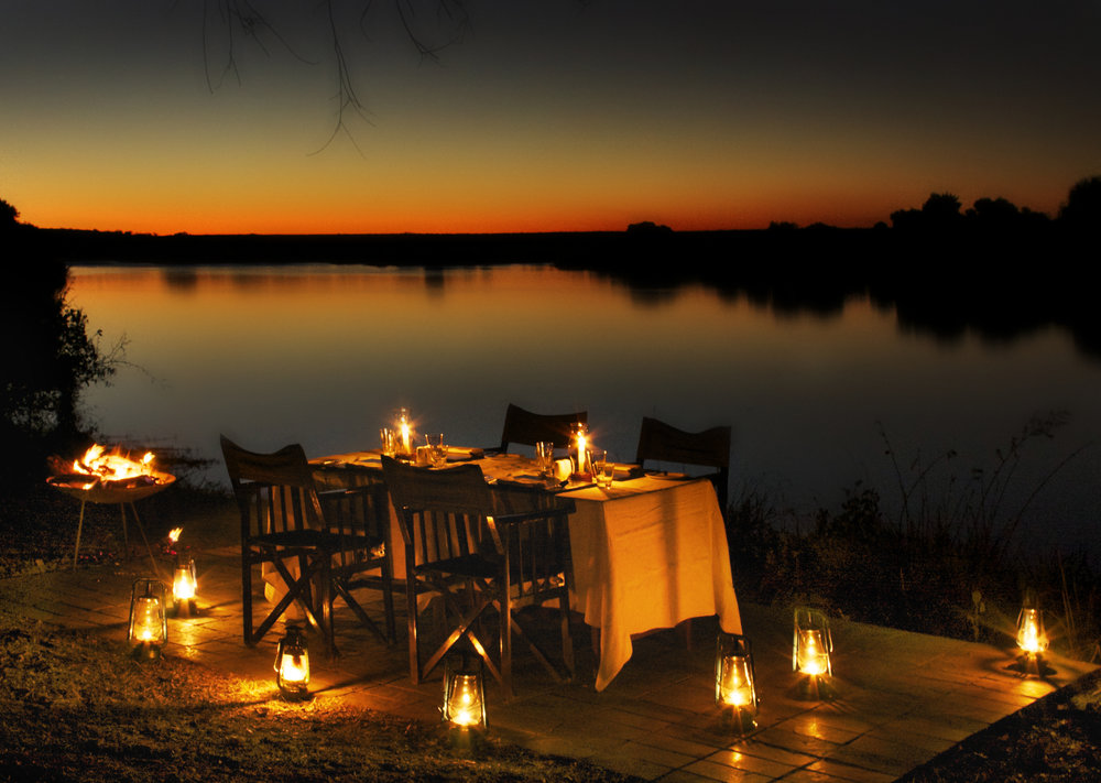 17. Imvelo Safari Lodges - Zambezi Sands River Camp - Dining on the river banks.jpg