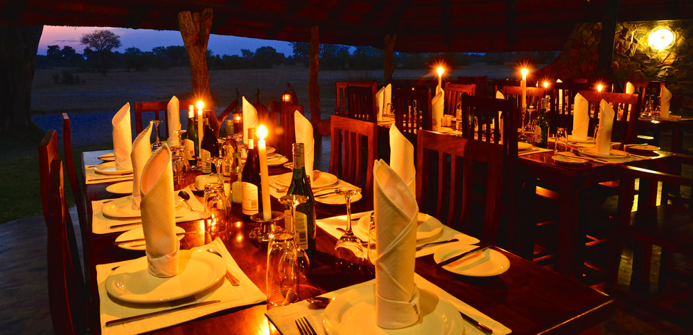 9. Imvelo Safari Lodges - Bomani Tented Dinig Area at Night.jpg