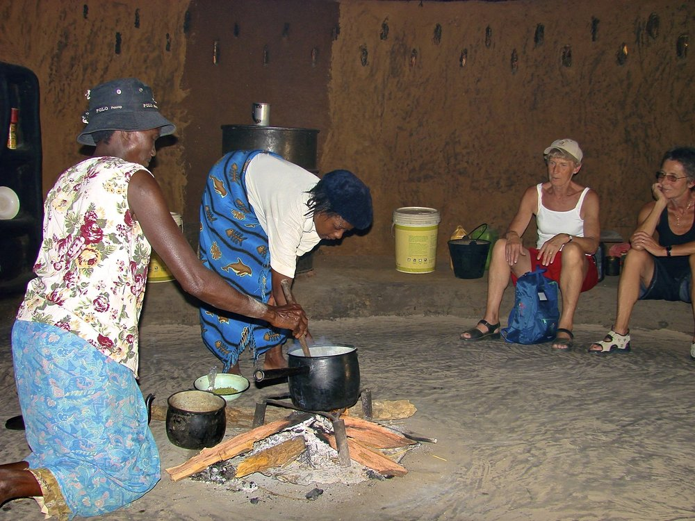 60. Imvelo Safari Lodges - Bomani Tented Lodge - Cooking porridge from millet during a village visit.jpg