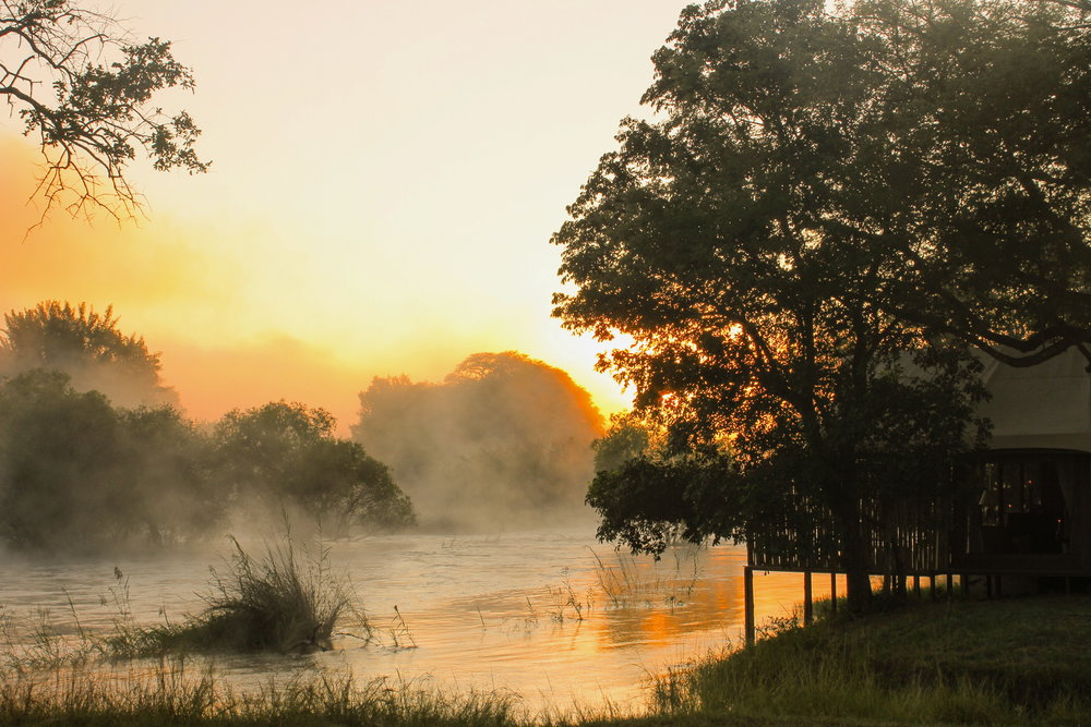35. Imvelo Safari Lodges - Zambezi Sands - Sunrise and mist on the Zambezi river.jpg