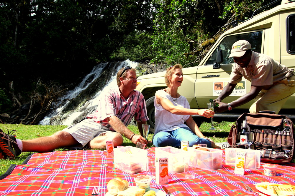 Picnic pouring drink.JPG