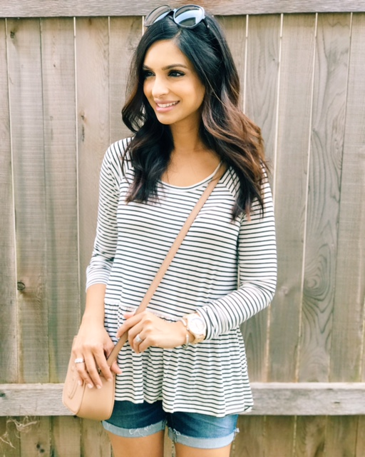 - I'm craving cooler weather but living in Austin, I'm just going to have to make do with this heat for a few more months! In the meantime, I'm sprinkling in some fall by pairing some of my favorite long sleeve tees with shorts. This striped peplum tee is adorable (I have it in both colors). It's easy to throw on with shorts now and will be worn into the fall layered with a cardigan or light jacket. Stripes are classic and I can dress up this tee with a statement necklace and heels too! This top is currently restocked but hurry before it's gone again!SHOP THE POST BELOW