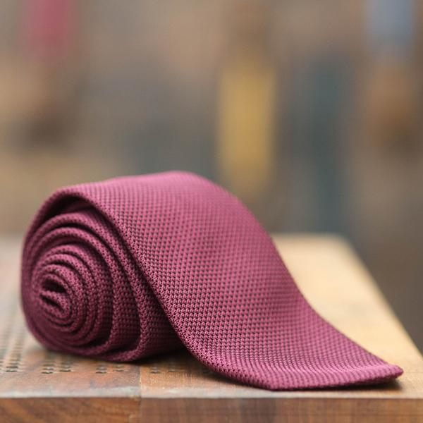 Most grooms are still going for ties instead of an open collar. So opt for one that is timeless and made by craftspeople in Italy like this one from  Monsieur London  they also do hats!