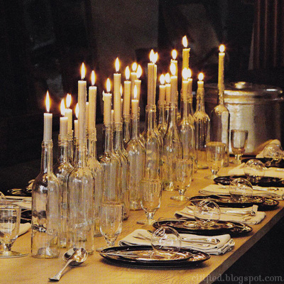 Got a romantic venue? Then skip the flowers and create drama with candles. Idea from  Elizabeth Anne designs.