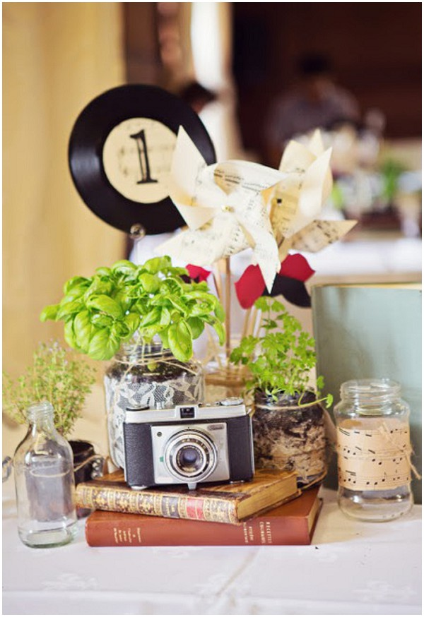 Use objects that tell your story. Loving the herbs too which can be picked and added to dinner!  Frenchweddingstyle.com