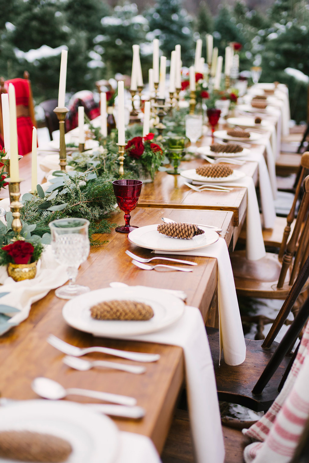 Candles (use soy or beeswax instead of parafin), pinecones, Christmas decs and greenery make a stunning table scape in this inspirational shoot on the  Ruffled Blog . Swap the out of season in the UK red roses for in season carnations, amaryllis or poinsettia.