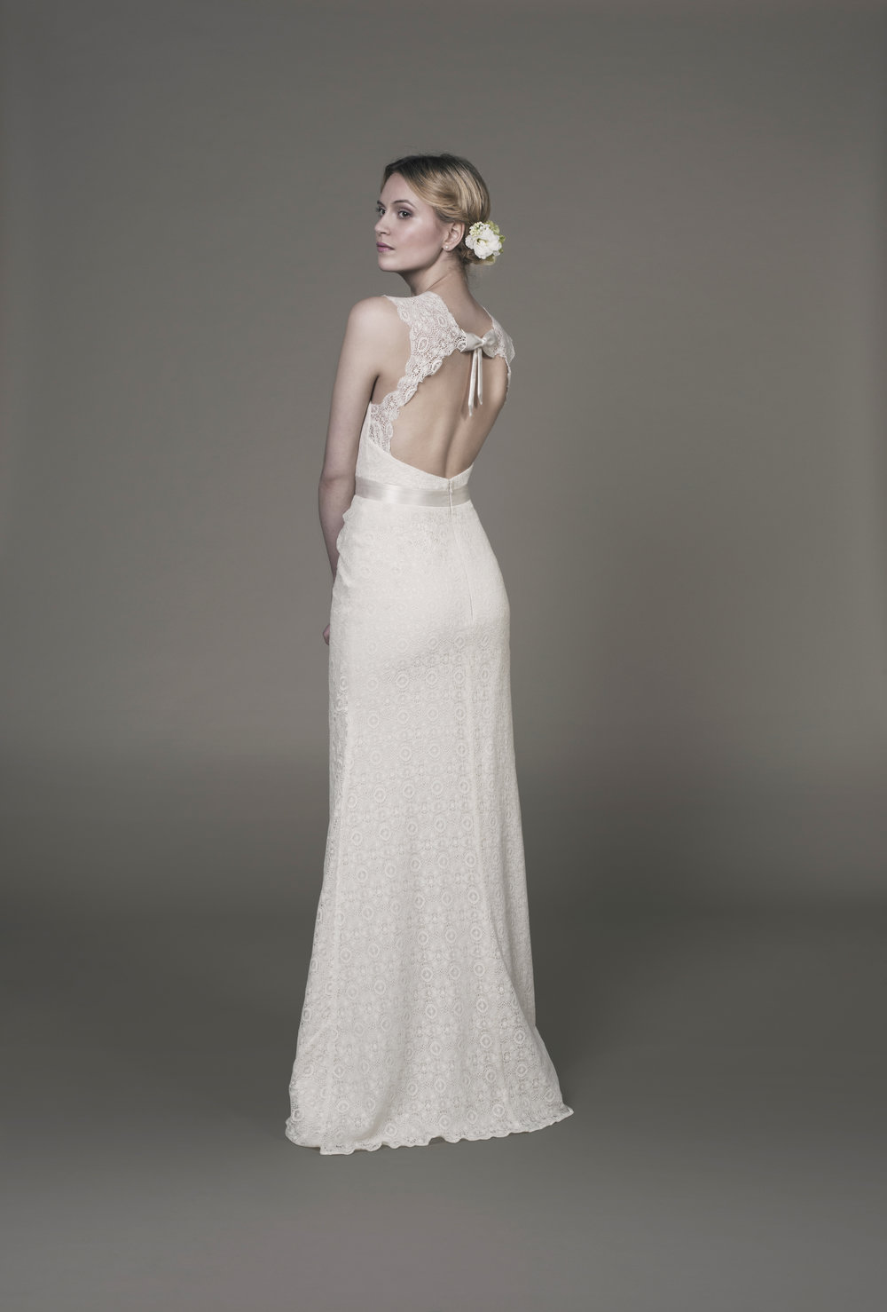 Bella gown 50% off - Stunning all over organic cotton lace wedding dress in natural cream colour. Fair trade made. Sample in perfect condition though lace straps may need taking in as have loosened from hanging. Vegan friendly wedding dress as outer and lining all organic cotton. £941.Size 12Measurements:Bust 36.5