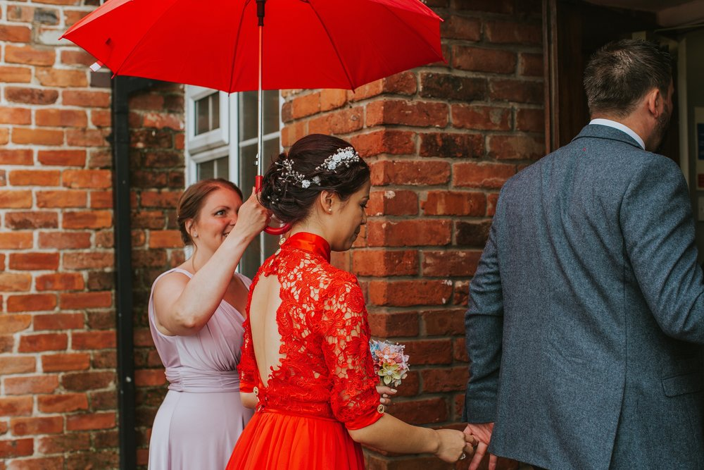 A bespoke red wedding gown