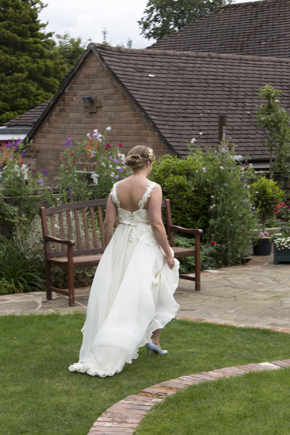 Bespoke wedding gown with vintage lace and silk