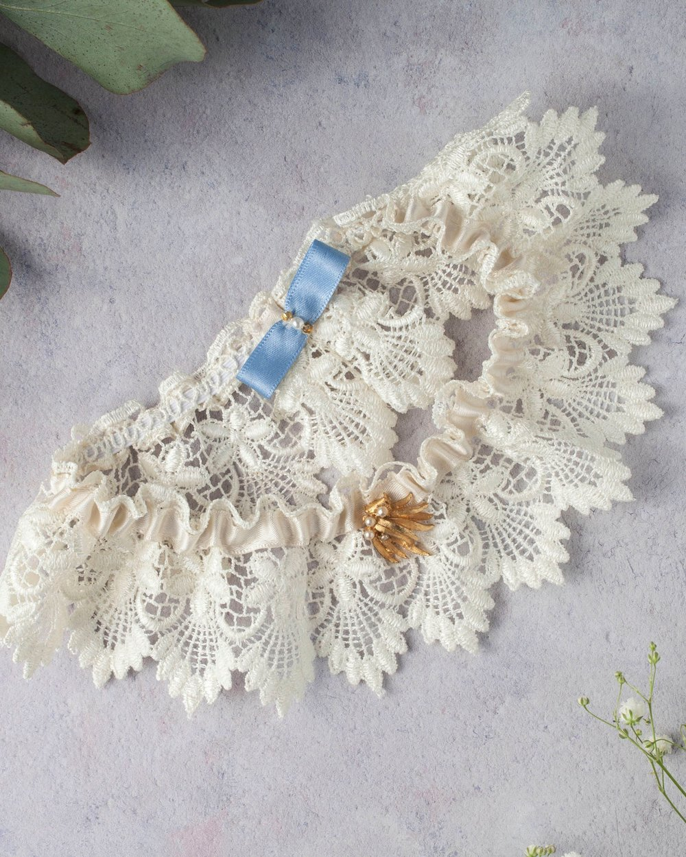 Add more lace! - And something blue! With the Persephone garter by Silversixpence in her shoe.