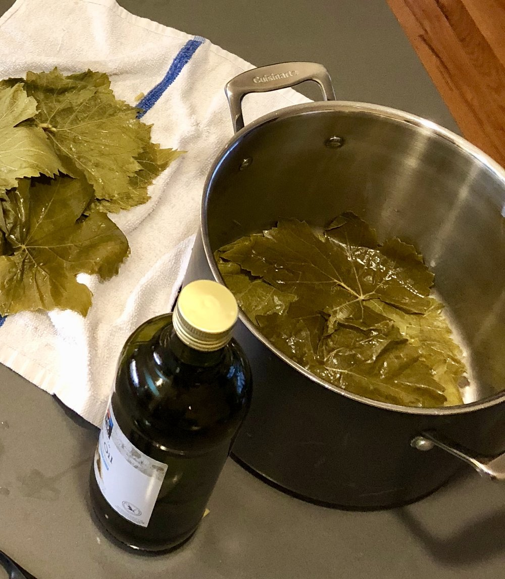 Line the bottom of the stock pot with grape leaves to prevent your dolmas from burning or browning. Use the broken or torn leaves.