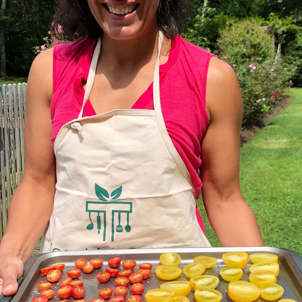 Just a chef showing off her tomatoes, and getting some sun on her guns. -