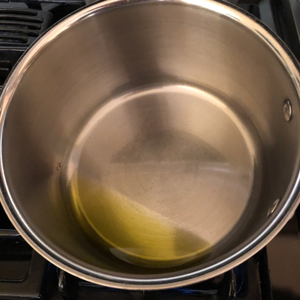 Add a thin layer of oil to an already heated pot over medium high heat.