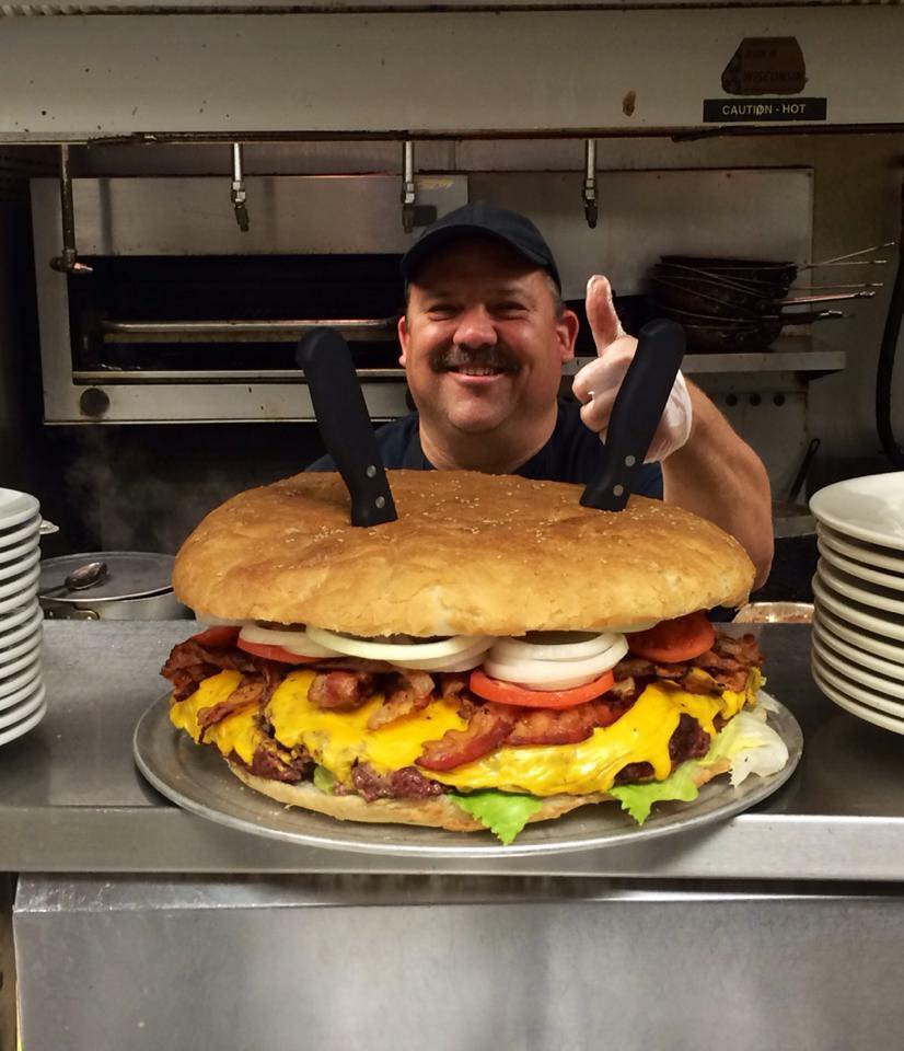 TEN POUND MONSTER BURGER             EAT IN UNDER ONE HOUR        AND IT'S FREE + YOU GET $100