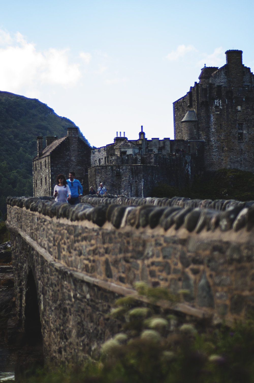 Couple crossing over to Eilean Donan
