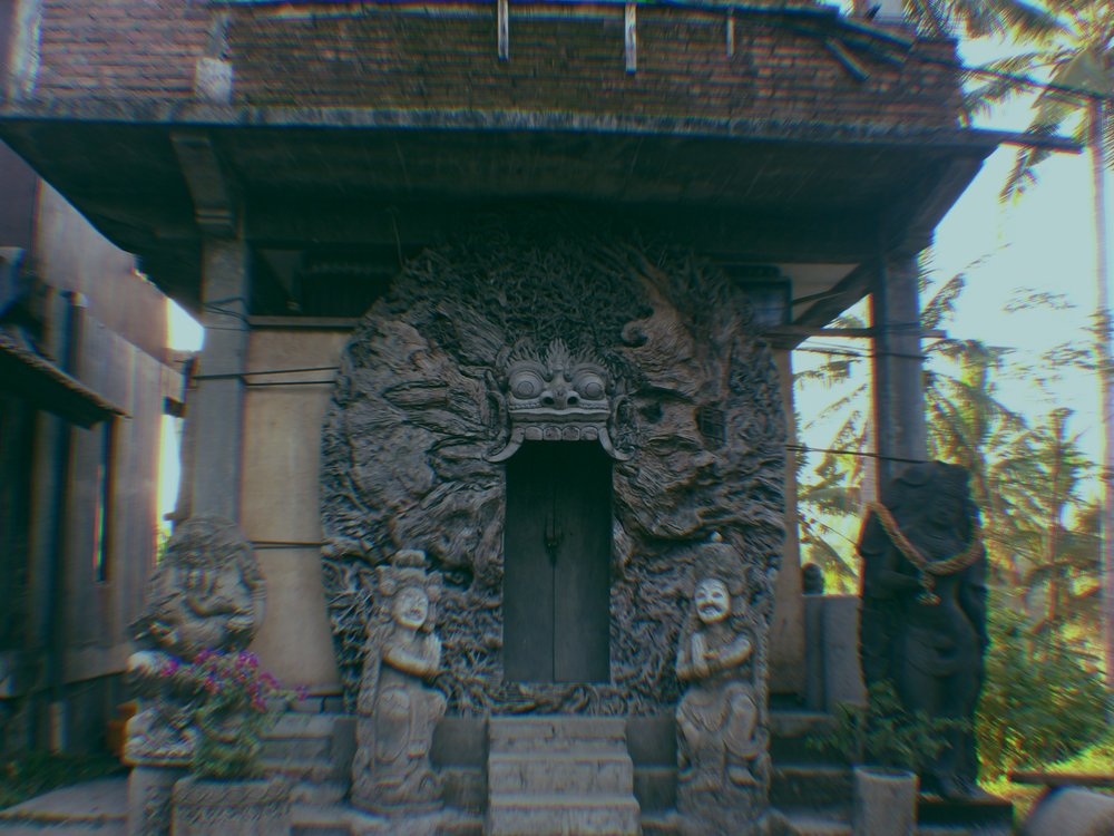 This door way, found on a walk from Ubud village, is carved from a tree trunk!!!