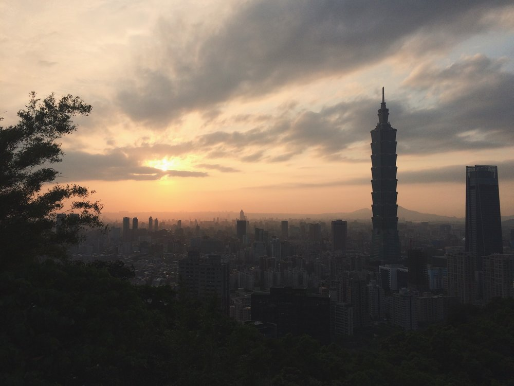 The sun setting over taipei, as seen from elephant mount