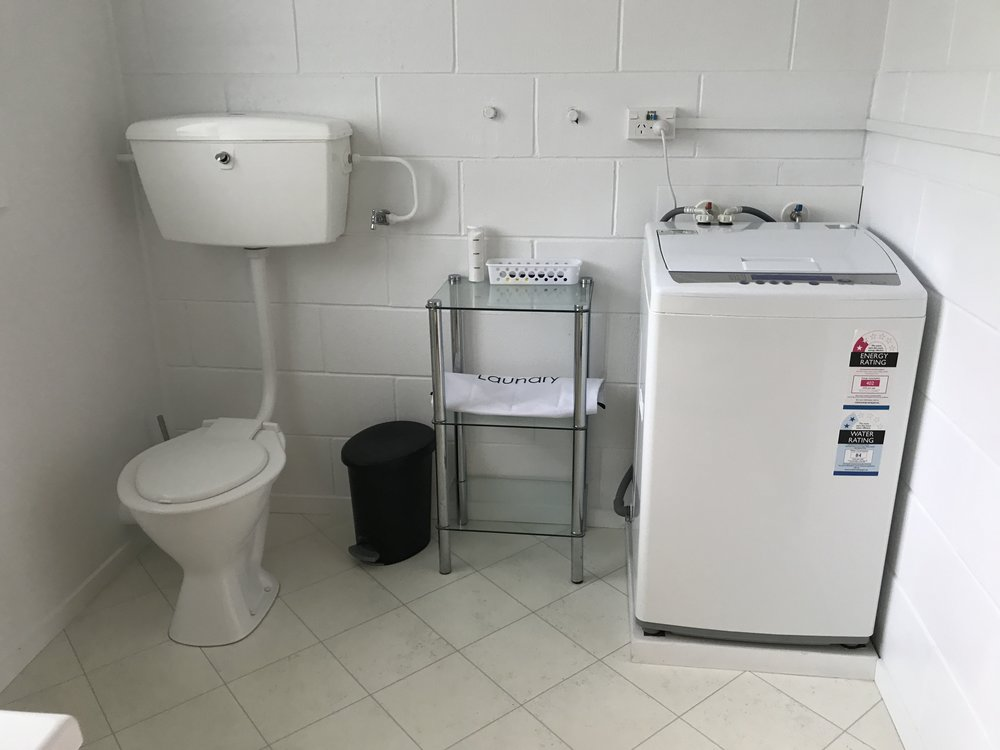 BATHROOM WITH LAUNDRY AND SHOWER