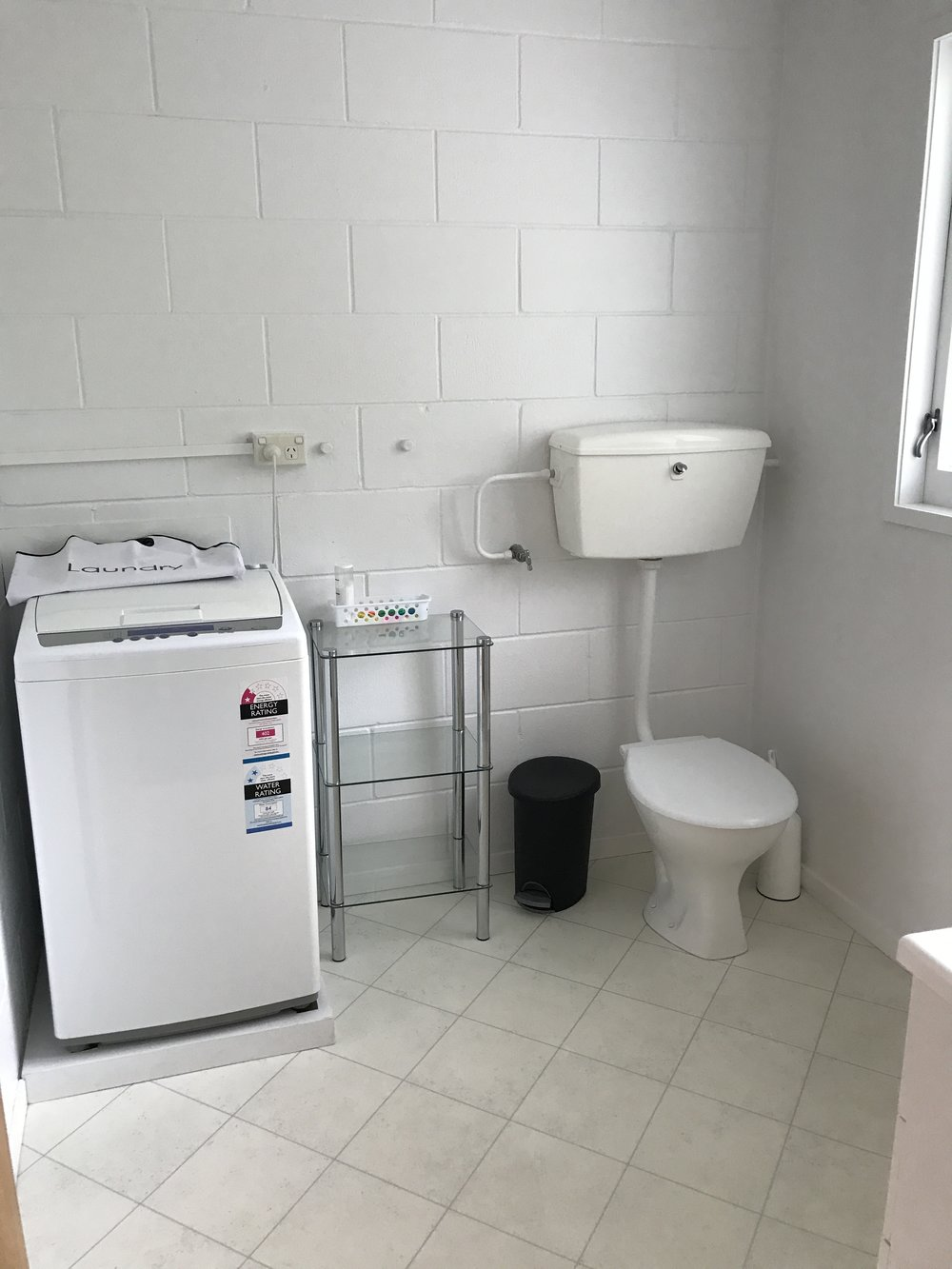 BATHROOM WITH LAUNDRY + SHOWER