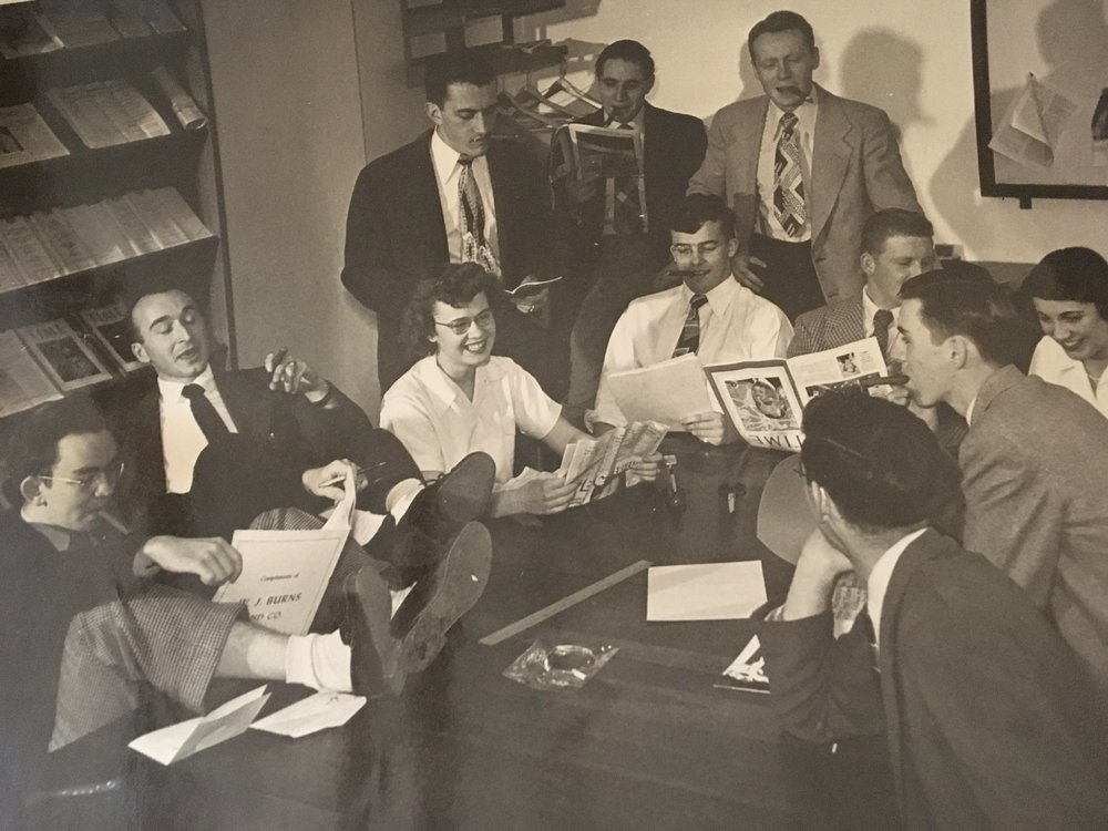 My father, at LeMoyne College (sitting to the right of the woman, pictured with a cigar in his mouth).