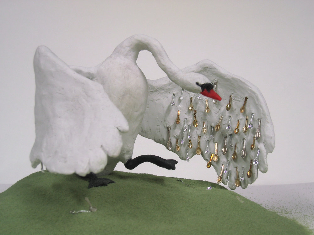 Spoon-feathered swan, 2008, Sculpey clay, dollhouse spoons, mixed media, 6 h x 9.5 w x 8.5 d in .