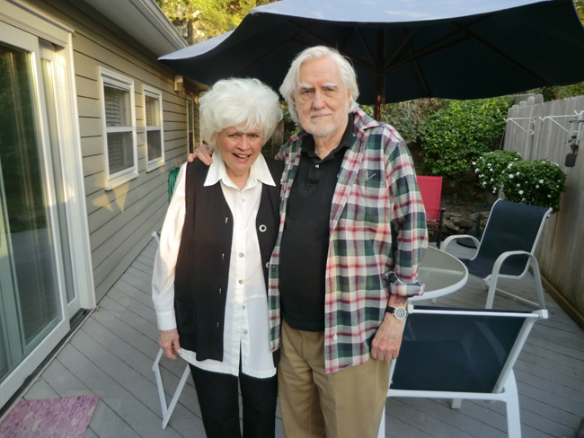 Charley and his wife, Ramoth, standing on their deck in Kansas City, MO.