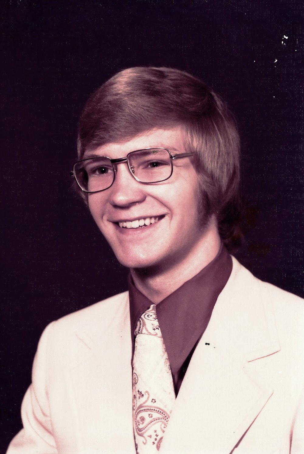 Senior in high school. Glasses were more acceptable in the wire-rimmed version.