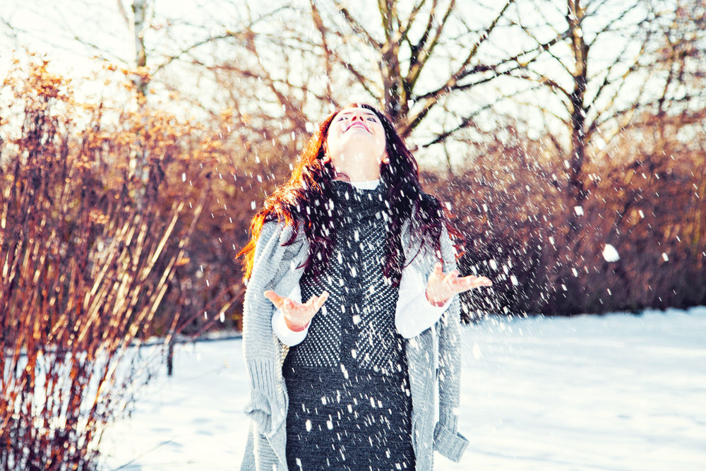 Girl-Laughing-Snow.jpg
