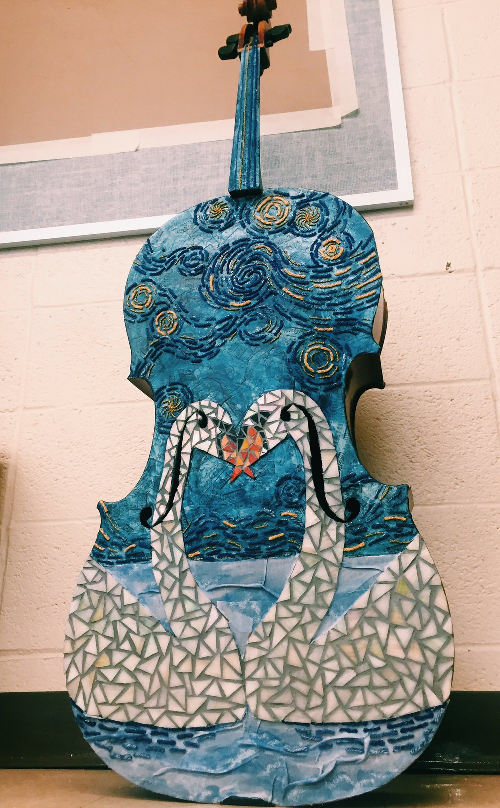 The Starry Night; 2015-2016 glass mosaic, cloth, yarn, music sheets, acrylics on a cello