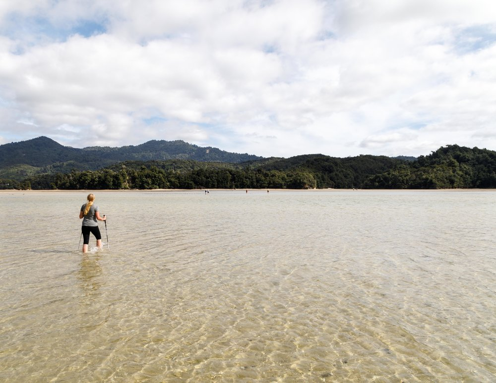 Crossing the Awaroa Inlet at low tide
