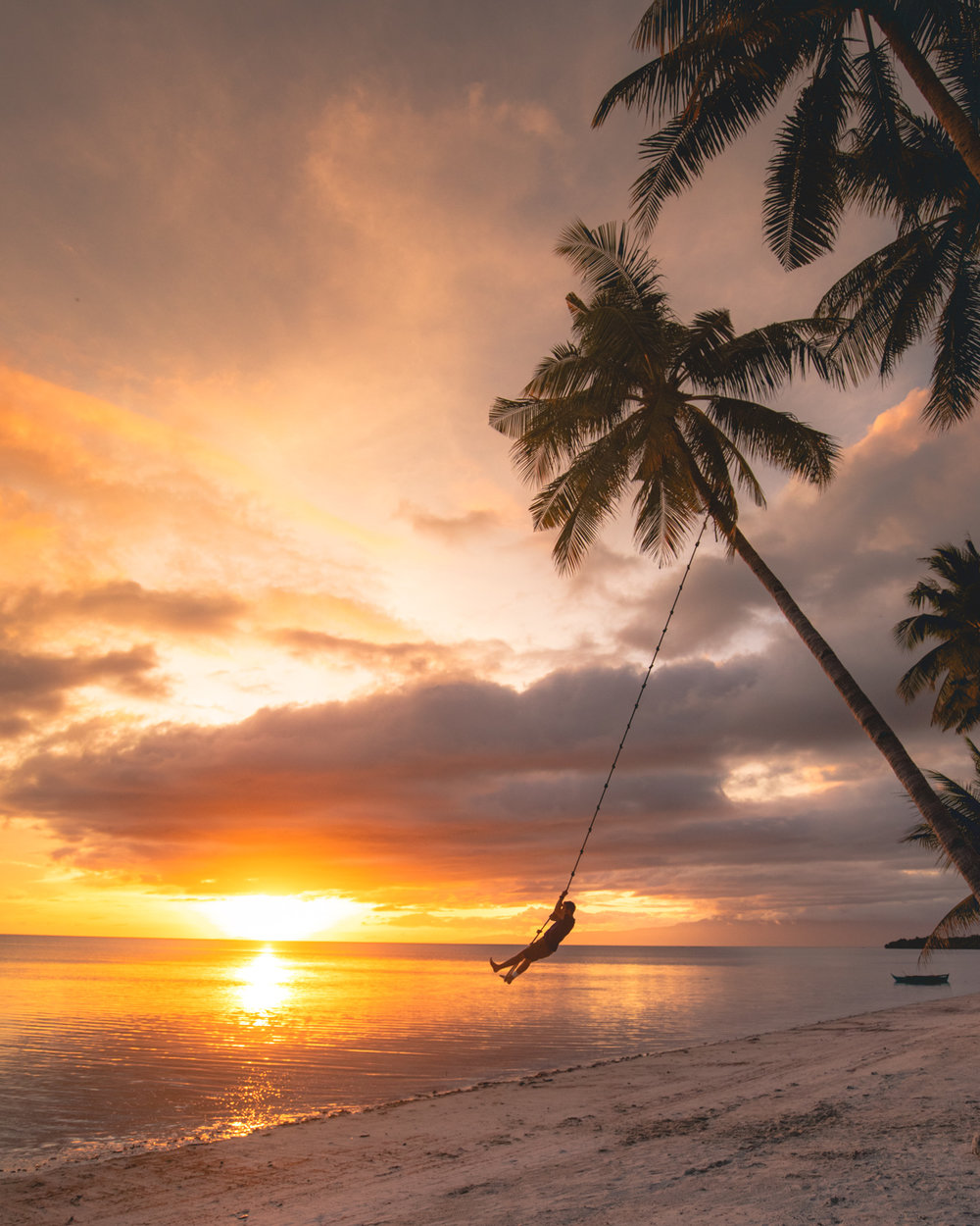 The swing at Coral Cay Resort at Sunset in Siquijor